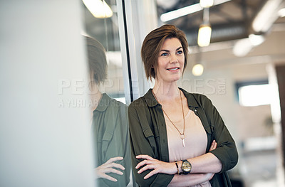 Buy stock photo Shot of an attractive young businesswoman looking thoughtful in an office