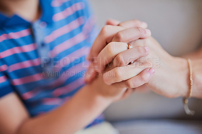 Buy stock photo Closeup shot of a mother and son holding hands at home