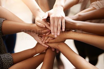 Buy stock photo Closeup shot of a group of people joining their hands together in a huddle