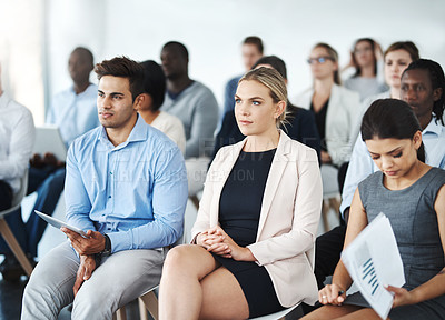 Buy stock photo Cropped shot of a group of businesspeople sitting in a lecture room during a seminar