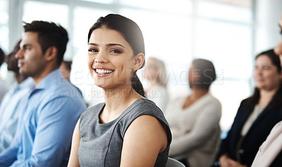 Buy stock photo Cropped portrait of an attractive young businesswoman sitting in a lecture room during a seminar