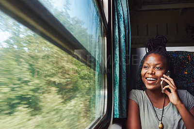 Buy stock photo Cropped shot of a young attractive woman on a call and traveling by train
