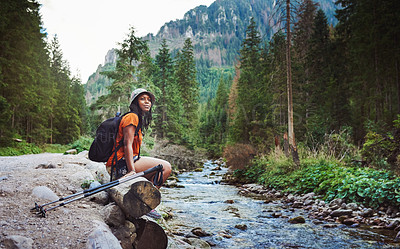 Buy stock photo Shot of a young attractive woman hiking in nature