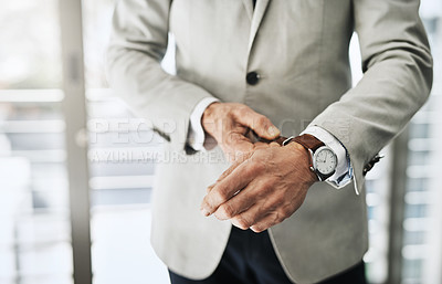 Buy stock photo Shot of an unrecognizable businessman attaching a watch to his wrist at home during the day