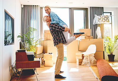 Buy stock photo Portrait of a happy mature couple embracing on moving day