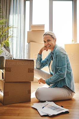 Buy stock photo Portrait of a mature woman using a laptop on moving day