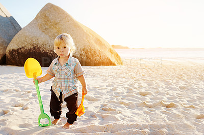 Buy stock photo Portrait of an adorable little boy playing at the beach