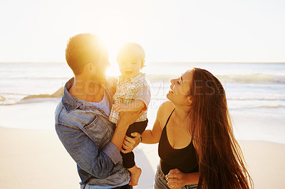 Buy stock photo Shot of a happy family having fun at the beach