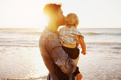 Buy stock photo Shot of an affectionate young man and his adorable son at the beach