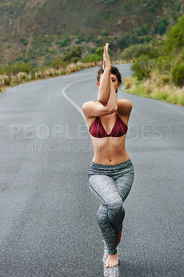 Buy stock photo Portrait of a young woman practicing yoga outdoors
