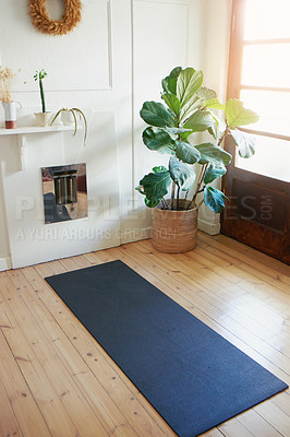 Buy stock photo Shot of a yoga mat in the living room at home with no people