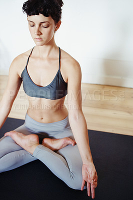 Buy stock photo Shot of a beautiful young woman doing yoga at home