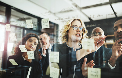Buy stock photo Shot of a group of businesspeople having a brainstorming session in a modern office