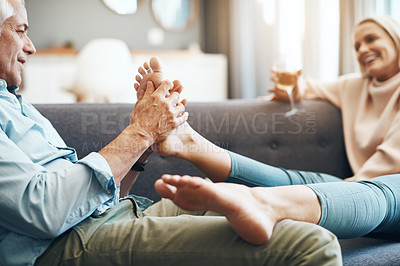 Buy stock photo Cropped shot of an affectionate mature couple relaxing on the sofa at home