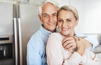Buy stock photo Cropped portrait of an affectionate mature couple in their home