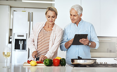 Buy stock photo Cropped shot of an affectionate mature couple preparing a healthy meal at home