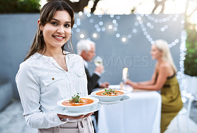 Buy stock photo Shot of a young waitress serving a mature couple on a romantic date
