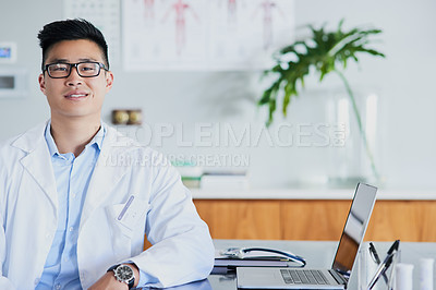 Buy stock photo Cropped portrait of a young male doctor working in his office in the hospital