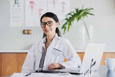 Buy stock photo Cropped portrait of a young female doctor working in her office in the hospital