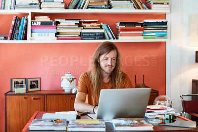 Buy stock photo Cropped shot of a man working on his laptop in a modern office