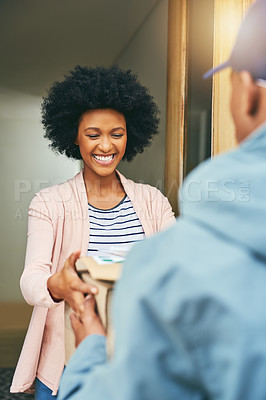 Buy stock photo Shot of a young woman receiving her delivery from the courier