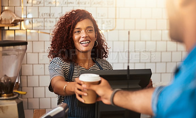 Buy stock photo Shot of a young barista serving a cup of coffee to a customer in a cafe