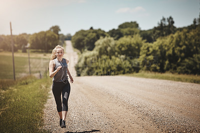 Buy stock photo Portrait of a young woman out on a trail run