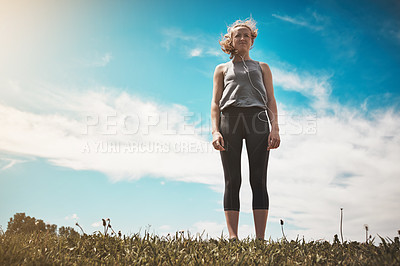 Buy stock photo Shot of a young woman taking a break while out for a run