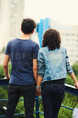 Buy stock photo Rearview shot of an unrecognizable teenage couple outdoors