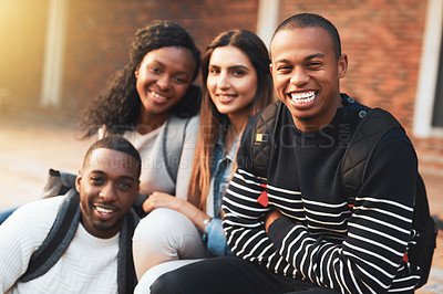 Buy stock photo Portrait of a group of students relaxing together during a break on campus
