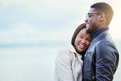 Buy stock photo Shot of an affectionate young couple bonding together outdoors