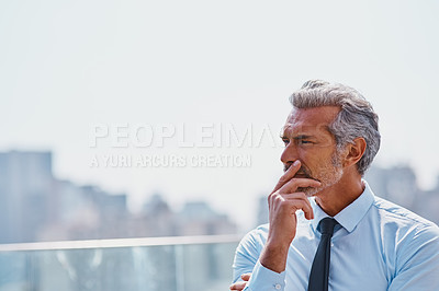 Buy stock photo Cropped shot of a mature corporate businessman contemplating outside