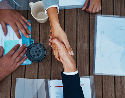 Buy stock photo High angle shot of unrecognizable corporate businesspeople shaking hands outside