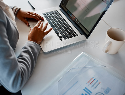 Buy stock photo Cropped shot of an unrecognizable corporate businesswoman using a laptop in the office