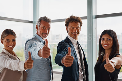 Buy stock photo Cropped shot of corporate businesspeople showing thumbs up in the office