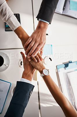 Buy stock photo High angle shot of unrecognizable corporate businesspeople joining their hands together in unity in the office