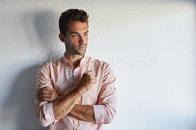 Buy stock photo Cropped shot of a handsome young businessman posing against a white wall