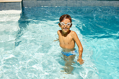 Buy stock photo Shot of a little boy swimming in a pool