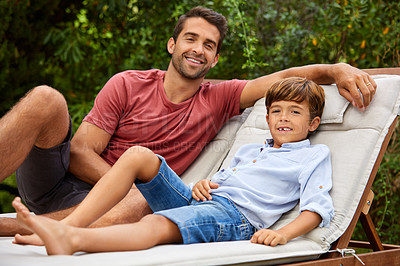 Buy stock photo Portrait of a father and son relaxing together outside