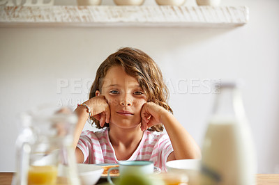 Buy stock photo Cropped shot of a little girl having breakfast at home