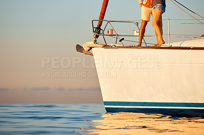 Buy stock photo Cropped shot of a couple going for a cruise out on the ocean