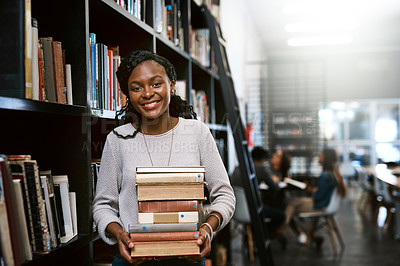 Buy stock photo Portrait of a happy young woman carrying books in a library at college