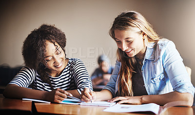 Buy stock photo Cropped shot of female university students in class
