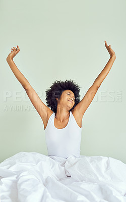 Buy stock photo Cropped shot of an attractive young woman waking up and stretching in bed at home