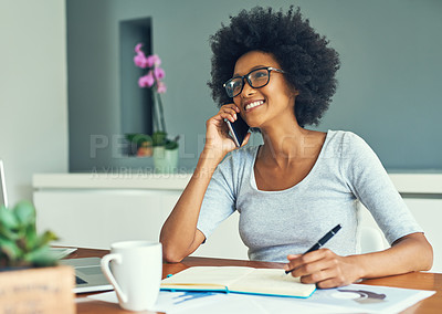 Buy stock photo Shot of a young woman working at home