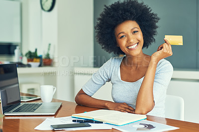 Buy stock photo Cropped portrait of an attractive young businesswoman doing her banking online at home