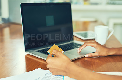Buy stock photo Cropped shot of an unrecognizable businesswoman doing her banking online at home