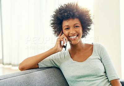Buy stock photo Cropped portrait of an attractive young woman chilling at home over the weekend