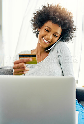 Buy stock photo Cropped shot of an attractive young woman using her laptop to shop online at home over the weekend