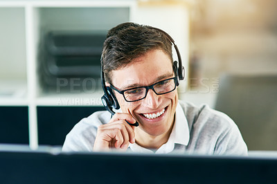 Buy stock photo Shot of a young call center agent working in an office